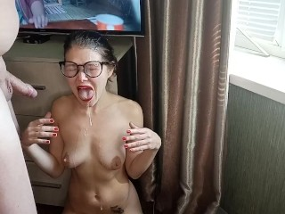 Cumshot on the face of a skinny oriental chick with glasses